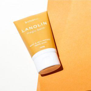 lanolin magic balm orange white background